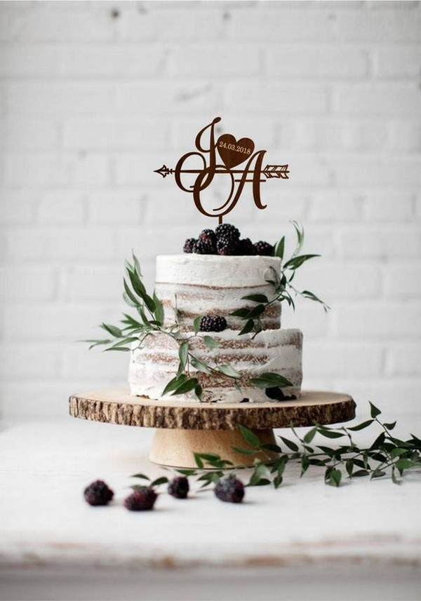 chic simple fall wedding cake with mulberries and greenery