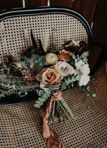 dusty orange and greenery boho wedding bouquet