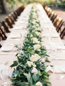 garland and white rose wedding table runner ideas