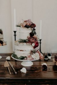 naked wedding cake with floral accents for fall 2019