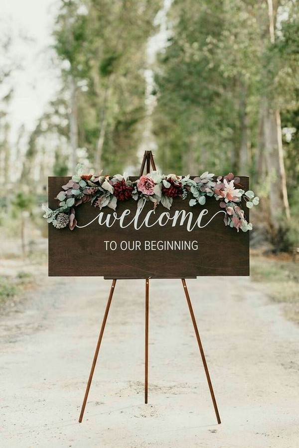 pretty wood wedding welcome sign with floral