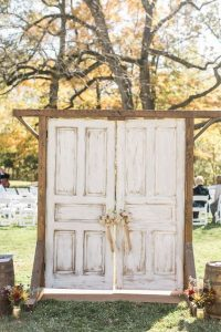 rustic wedding ceremony entrance with old doors