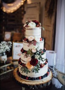 semi naked wedding cake with floral and fruits
