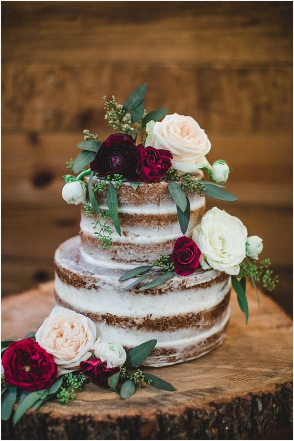 semi naked wedding cake with flowers