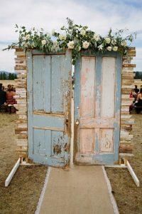 vintage door inspired outdoor wedding entrance