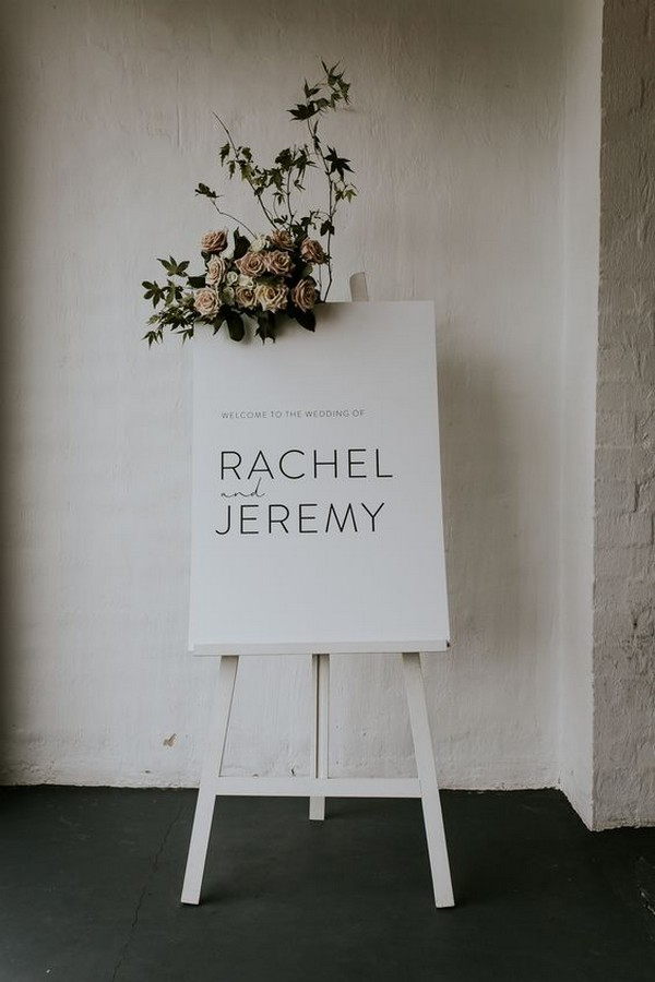 white wedding welcome sign with floral detail