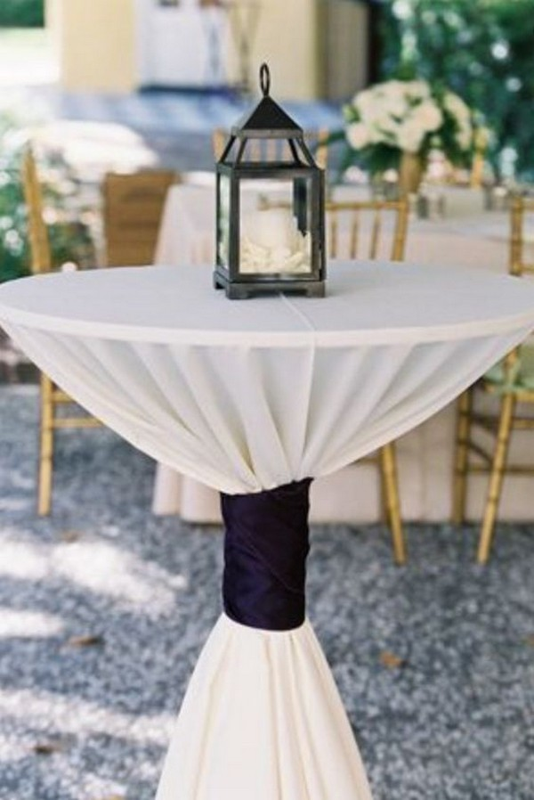 chic wedding cocktail table with black ties