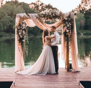 dusty rose floral wedding arches