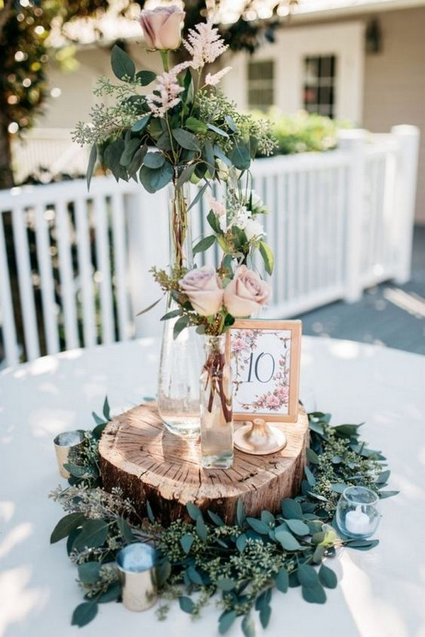 dusty rose wedding centerpiece with tree stumps