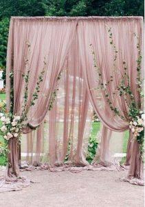 dustyr rose and greenery wedding arch