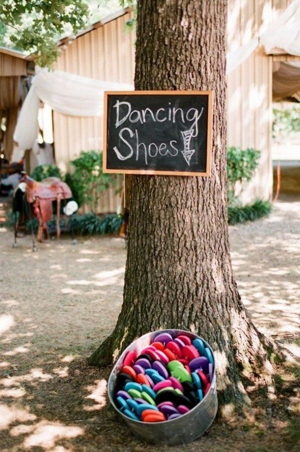 outdoor wedding details flip flop dancing shoes