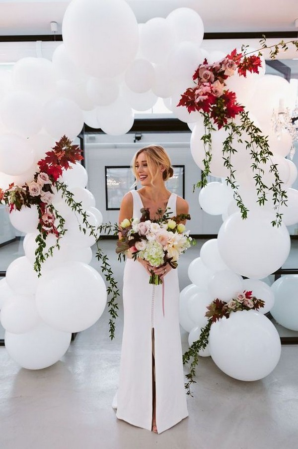 Gorgeous balloon wedding arch with floral