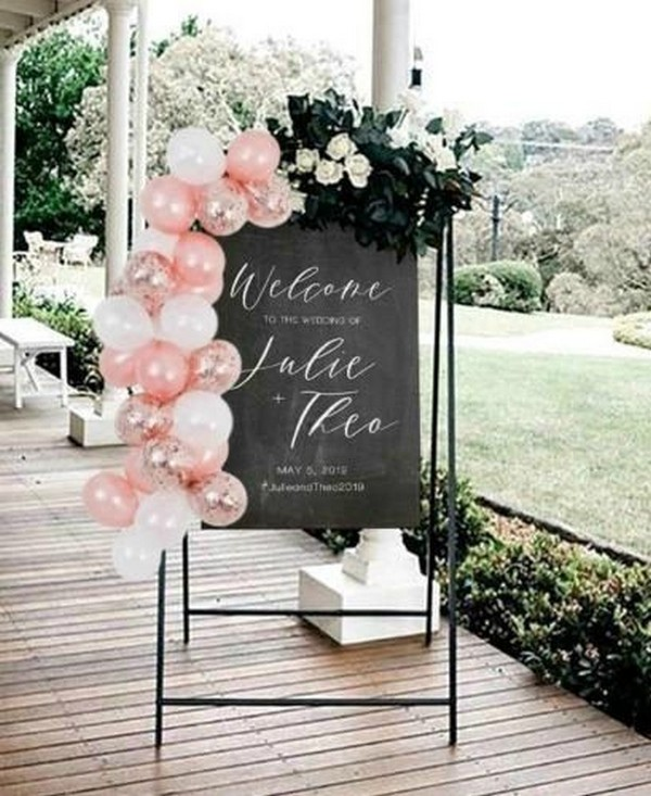 chalkboard wedding sign with pink balloons