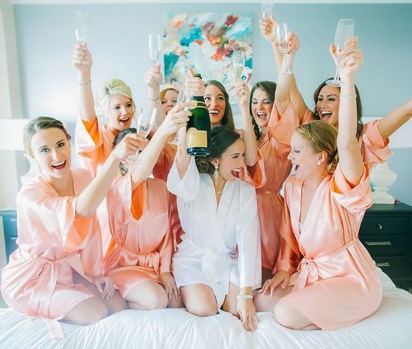 champagne cheers getting ready wedding photo with bridesmaids