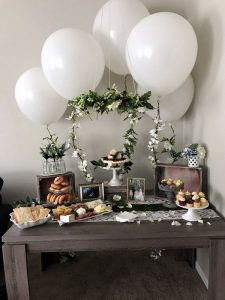 chic wedding dessert table with balloons