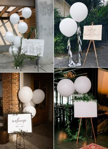 chic wedding signs with white balloons decorations