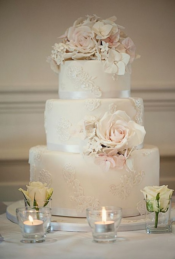elegant vintage wedding cake with lace appliques