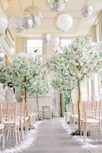 elegant winter wedding ceremony ideas with balloon ceiling