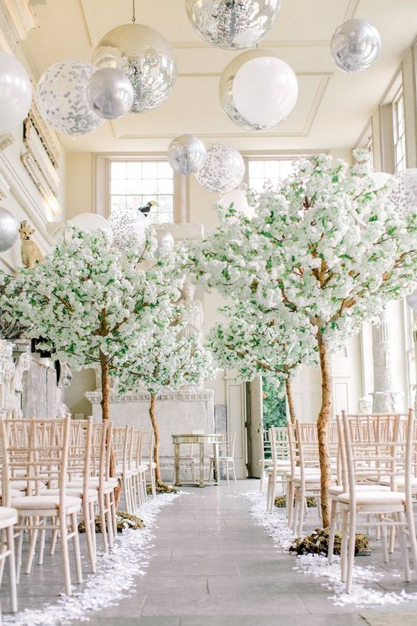 elegant winter wedding ceremony ideas with balloon ceiling