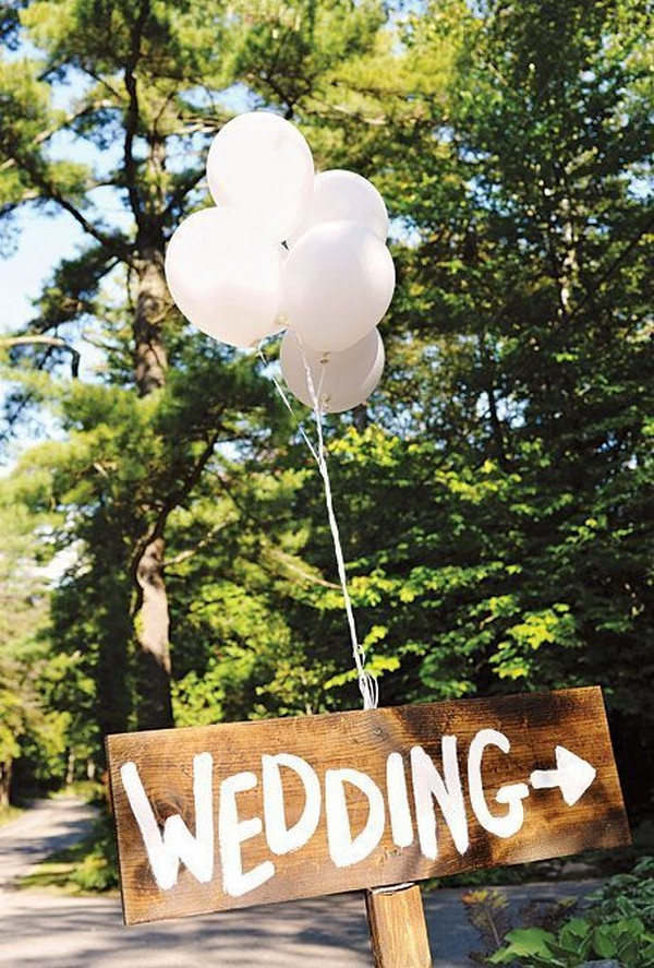 outdoor wedding sign with balloon decorations