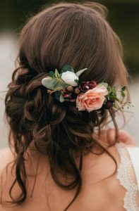 romantic updo wedding hairstyle with florals