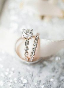 round cut vintage engagement ring with wedding band
