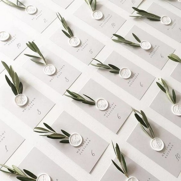 simple elegant wedding escort cards with olive branch details