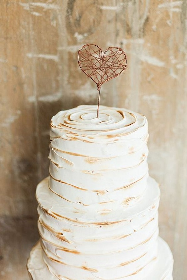 simple vintage wedding cake with heart cake topper