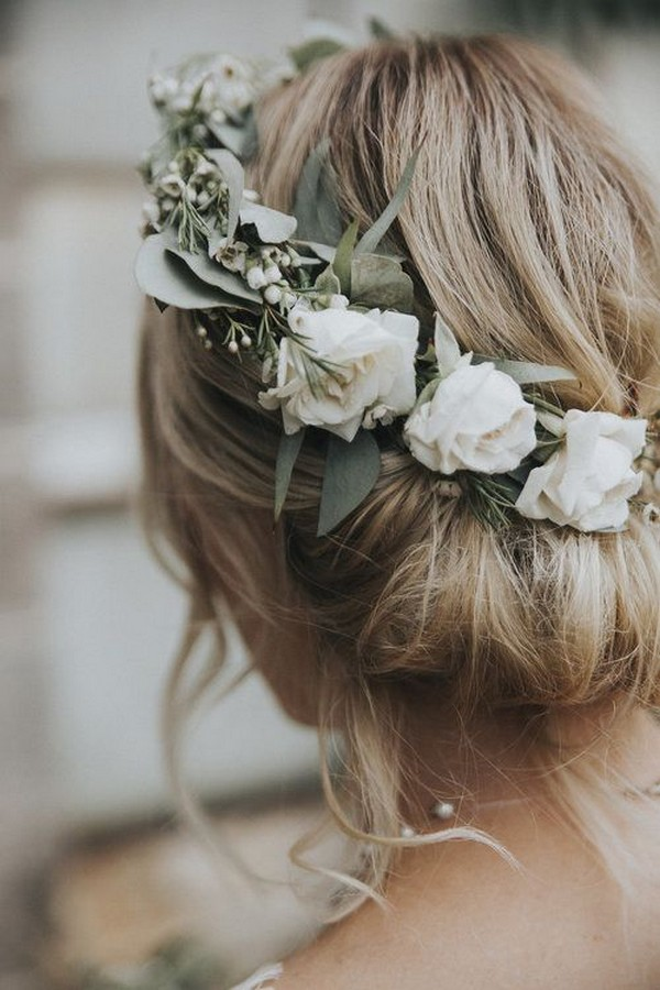 updo wedding hairstyle with white and greenery floral crown