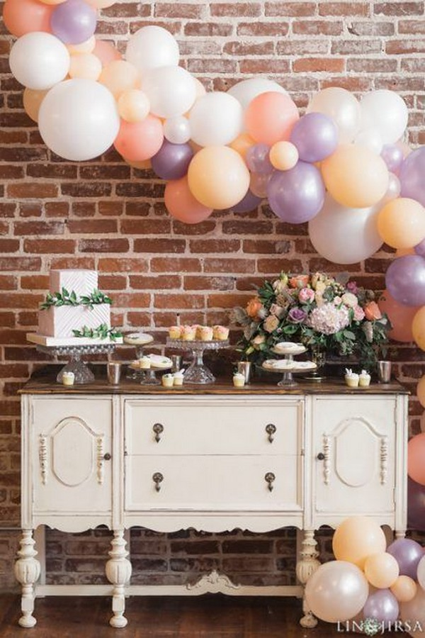 vintage chic wedding dessert table with balloons