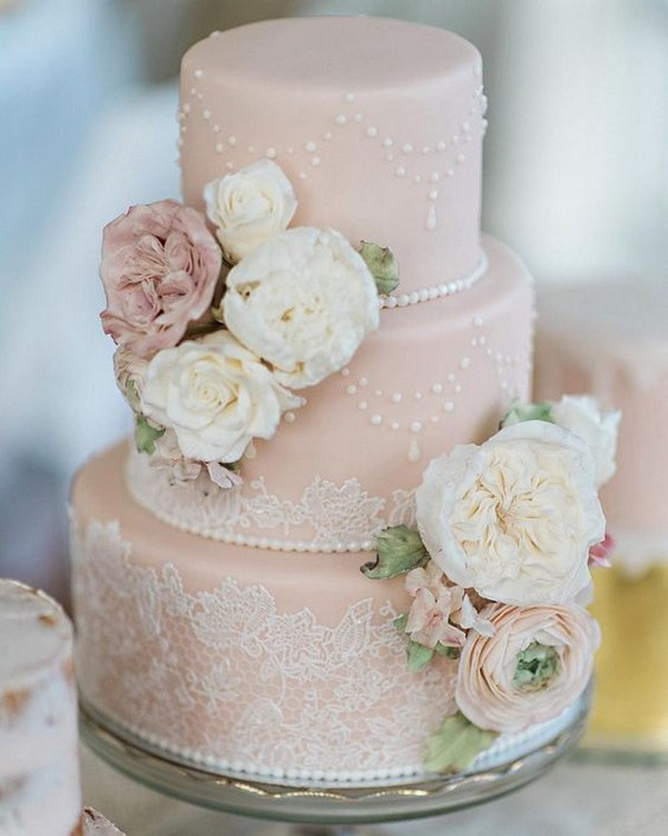 vintage pink wedding cake with lace and floral details