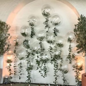 wedding backdrop ideas with greenery and balloons