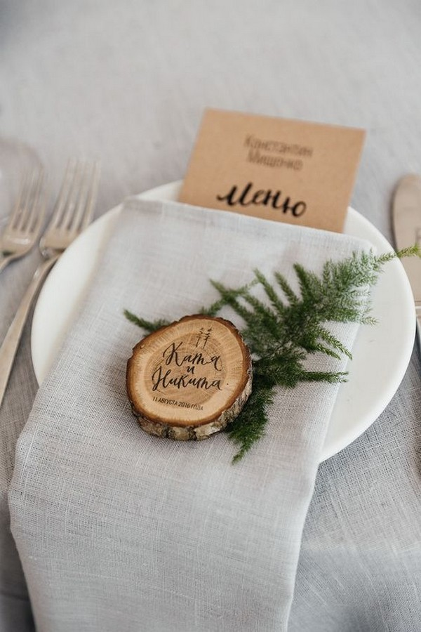 winter evergreen and tree stumps wedding decoration ideas