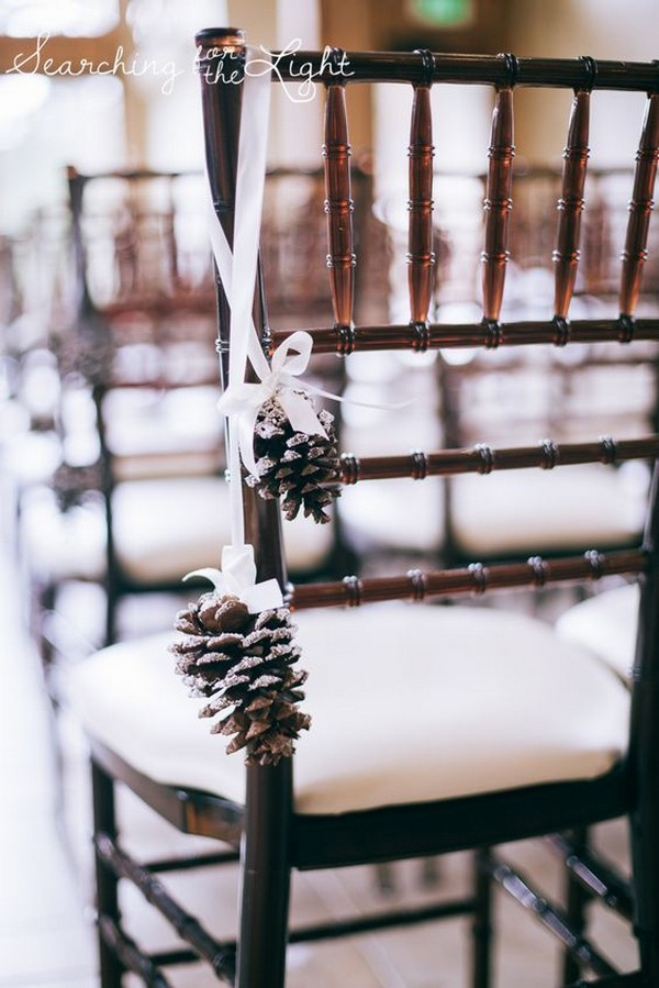 winter wedding ceremony chair decoration ideas with pine cones
