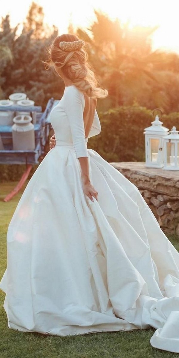 Modern simple open back bridal gown with sleeves