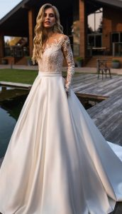 Princess lace bridal gown with long sleeves and satin skirt