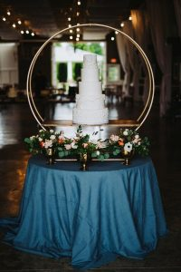 all white wedding cake with hoop stand