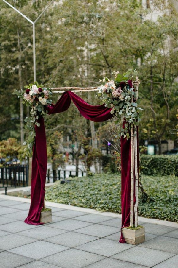 burgundy and greenery fall wedding arch