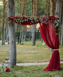 burgundy fall wedding arch ideas