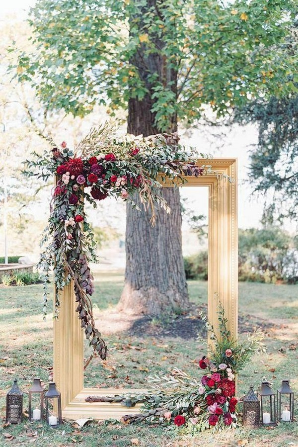gold and burgundy fall wedding arch