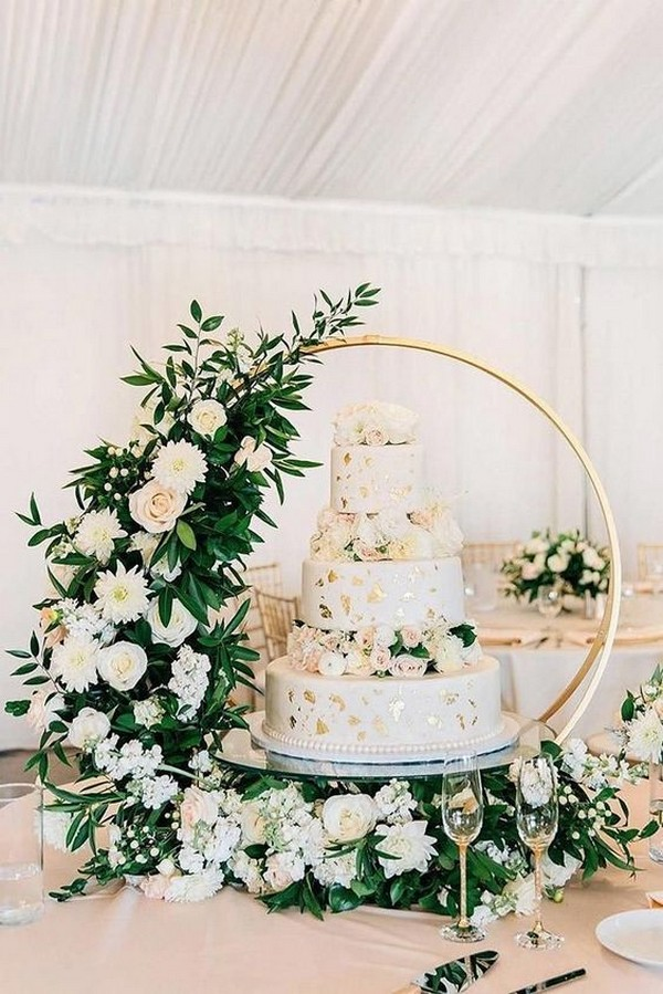 gorgeous floral wedding cake with hoop stand