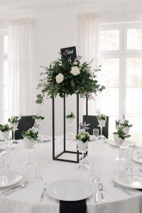 green and black tall wedding centerpiece