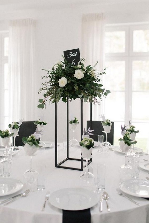 green and black tall wedding centerpiece