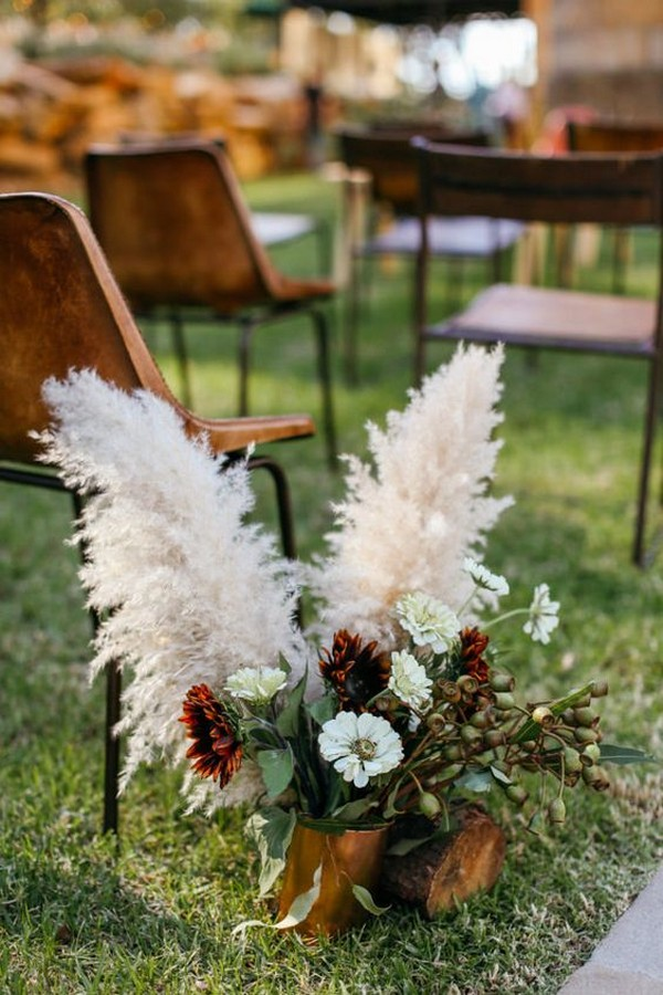 outdoor wedding aisle ideas with pampas grass and floral