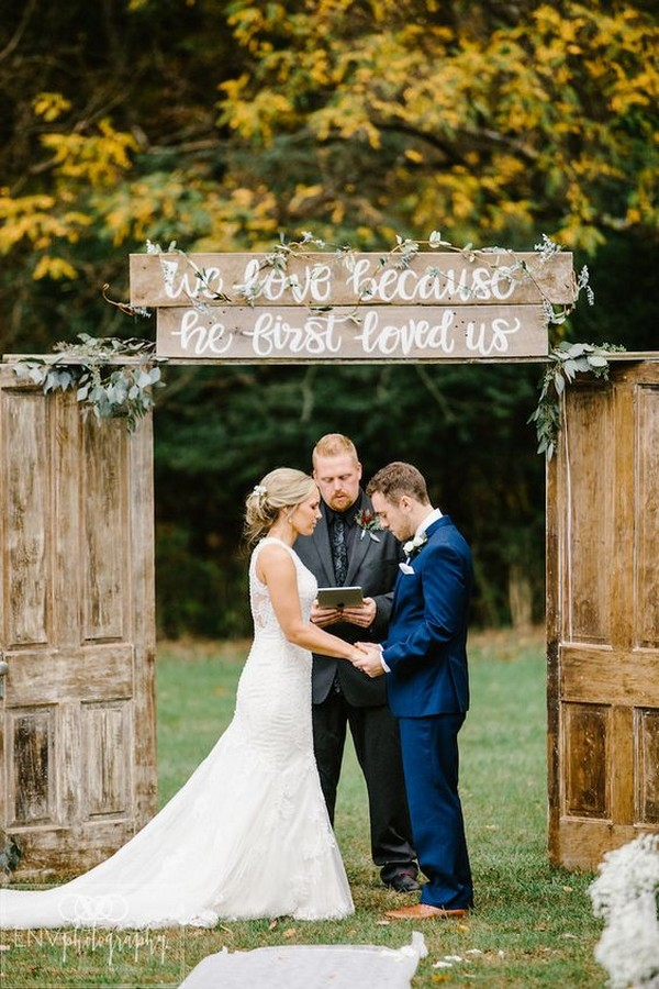 rustic outdoor wedding arch with vintage doors