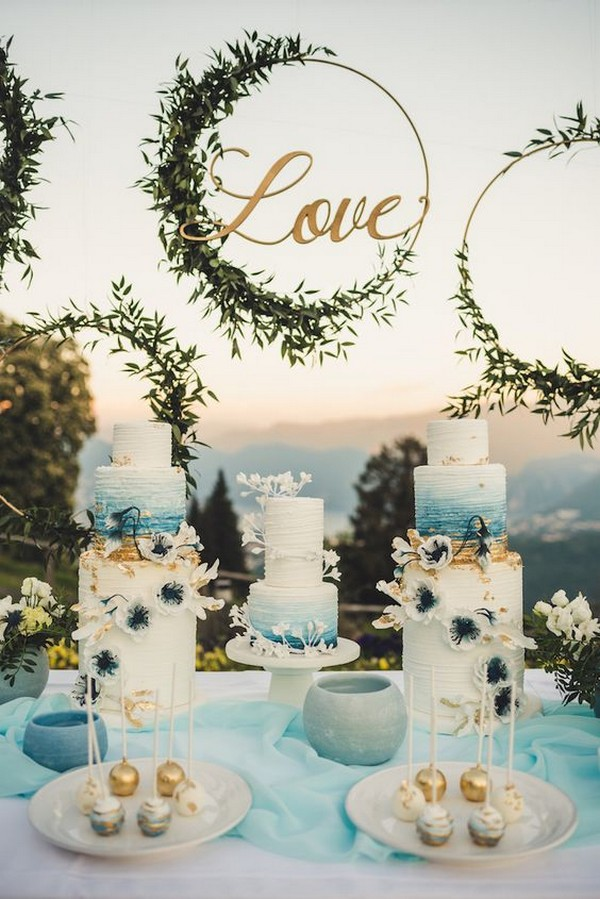 shades of blue wedding cakes with hanging hoops