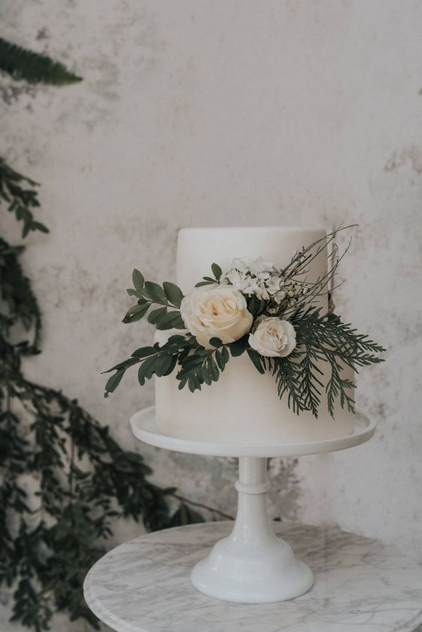 simple elegant wedding cake with peach and greenery