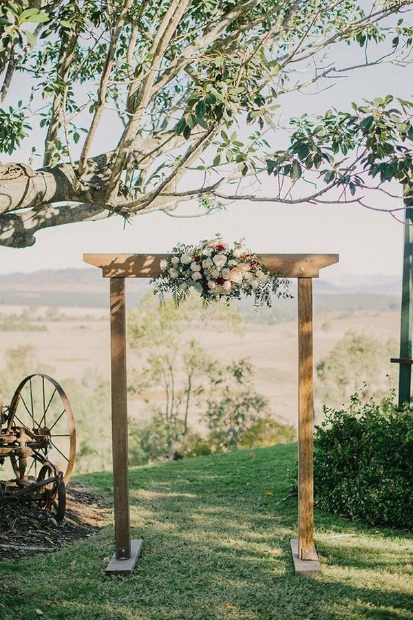 simple rustic fall outdoor wedding arch