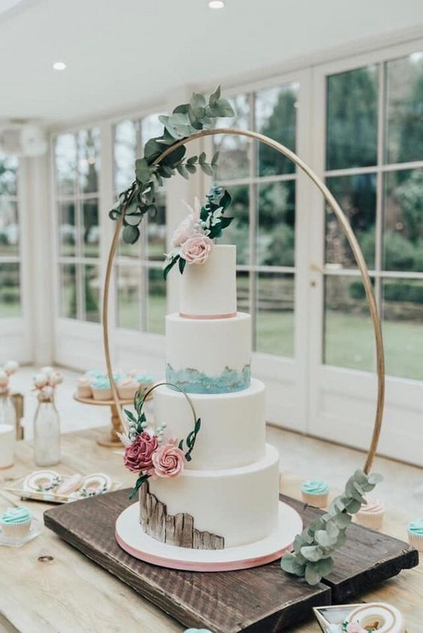 trending floral wedding cake with hoop stand