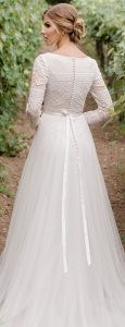 vintage lace wedding dress with long sleeves and bow